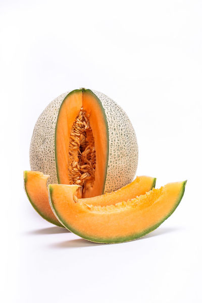Melon Food Food And Drink Freshness Fruit Healthy Eating Healthy Lifestyle Melon No People Orange Color Raw Food Seed SLICE Studio Shot Vitamins White Background Yellow Melon