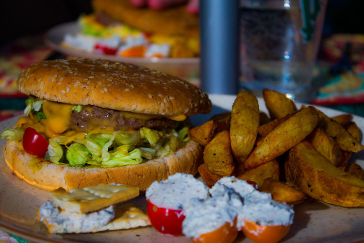 Close-up of burger and french fries on plate