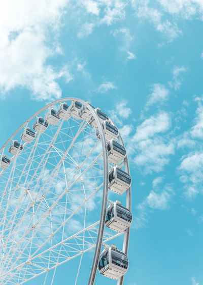 Amusement Park Ride Amusement Park Ferris Wheel Sky Arts Culture And Entertainment Cloud - Sky Low Angle View Nature Day Blue No People Built Structure Architecture Shape Geometric Shape Circle Leisure Activity Outdoors Large Traveling Carnival Fairground Wheel Sky And Clouds Sky_collection Wallpaper