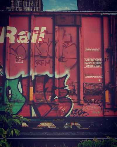 #EyeEmNewHere #EyeEm Best Shots #eyeemoftheweek Graffiti No People Architecture Text Day Built Structure Wall - Building Feature Metal Building Exterior Art And Craft Outdoors Communication Western Script Creativity Wall Entrance Brick Wall Door Nature