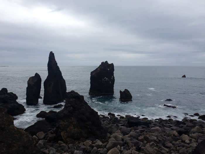 Reynisdrangar, Iceland. Basalt sea stacks near village of Vík i Myrdal, Iceland. Famous black sand beach under Reynisfjall Mountain. Top sights to visit in Iceland. Basalt Beach Beauty In Nature Black Sand Beach Black Sand Beach Iceland Black Sand Beach# Day Horizon Over Water Iceland Iceland Trip Icelandtrip Nature No People Outdoors Reynisdrangar Rock - Object Rock Formation Scenics Sea Sky Tranquil Scene Tranquility Water