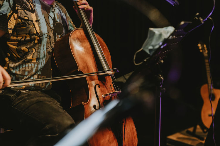 Man playing cello at music concert
