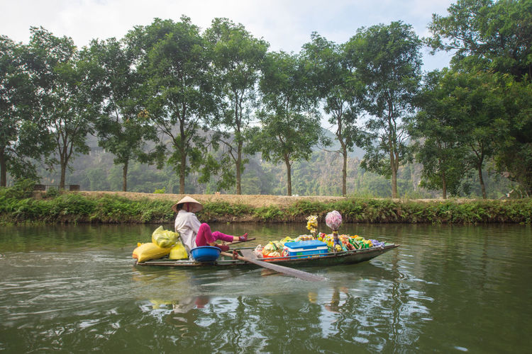 Tam Coc, Vietnam Tree Water Plant Real People Lifestyles Leisure Activity Nautical Vessel Men Transportation Waterfront Day Childhood Child Nature Lake Girls Women Family Group Of People Outdoors Tam Coc Vietnam Travel