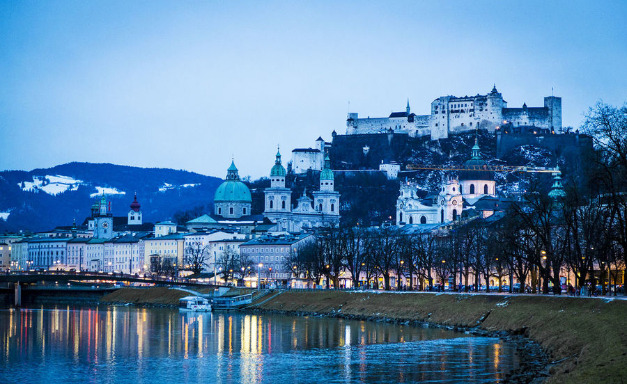 Salzburg by night Architecture Blue Building Exterior Built Structure City Cityscape Clear Sky Color Mountain Nature Nautical Vessel Night Nightlife No People Outdoors Reflection Salzburg Salzburg, Austria Sky Streetlights Travel Travel Destinations Tree Water Waterfront The Week On EyeEm