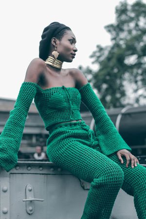 All knitted for a beauty portrait. All in Africa. Fresh On Eyeem  Fresh On Market 2018 EyeEm Best Shots Eyemphotography Eye4photography  Canon EyeEmNewHere Vintage Women City Portrait Standing Fashion Sky Green Color Thoughtful Ceremonial Make-up Fashion Model Posing Eye Make-up Artist's Model Hair Bun Society Beauty Face Powder Fashion Show