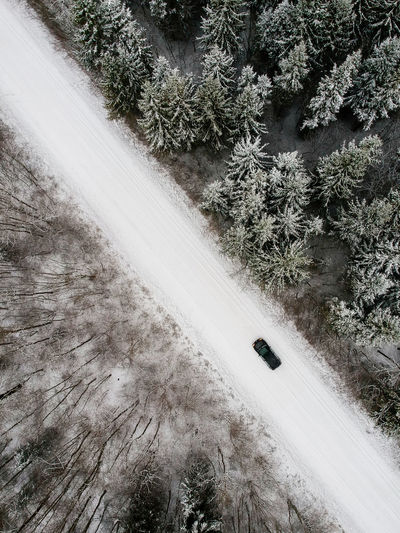 wv golf in winter forest. Car Lietuva Lithuania Wood Forest Dronephotography Snow Tree Aerial View White Aesthetics Nice Drones Beautiful View Winter Water Spraying Cold Temperature Frozen Deep Snow Snowfall Season  WoodLand Moving Vintage Car Car Point Of View Parking Covering Farmland 17.62°