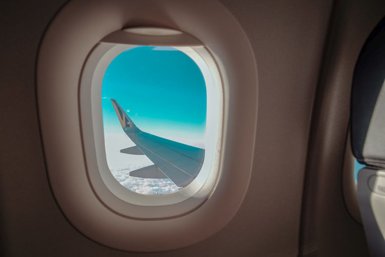 View of airplane through window