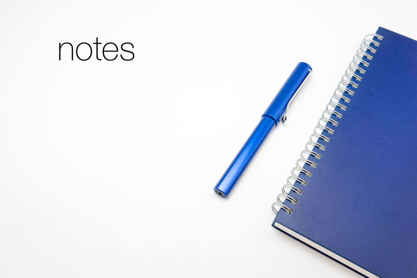Word Notes with notebook and pen in white isolated background Action Plan Blue Checklist Close-up Colored Pencil Cut Out Education Equipment Idea Ideas Isolated White Background Man Made Object No People Notebook NotePad Notes Office Supply Pen Pencil Stationary Still Life Studio Shot Variation White Background Writing Instrument