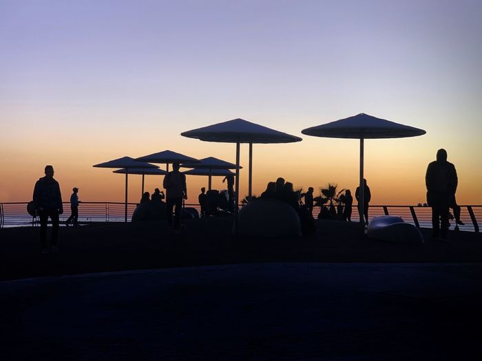 Sunset Sunset Sky Silhouette Group Of People Real People Men Sunset Leisure Activity Sea
