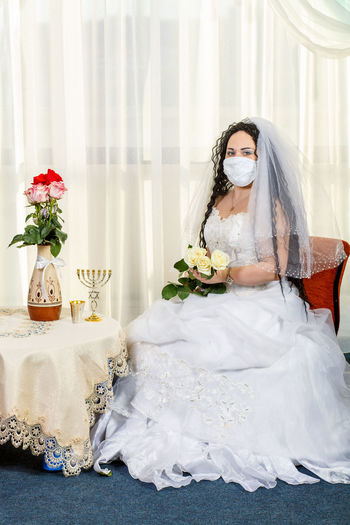 Woman holding flower bouquet