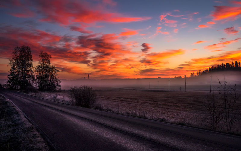 Sky is burning Asphalt Atmosphere Atmospheric Mood Autumn Clouds Country Countryside Dramatic Sky Fall Colors Field Fields Fog Foggy Landscape Mist Misty Morning Outdoors Road Sky Sunrise Sunset Tarmac Tree Trees