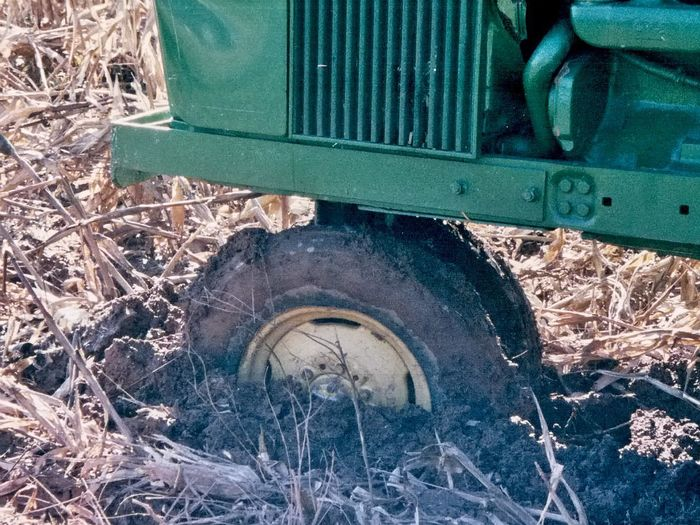 Tractor Agricultural Machinery Close-up Day Grass Mud No People Outdoors Stuck Stuck In Mud Tire Wheel