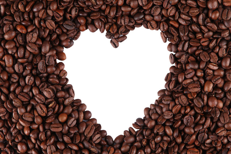 High Angle View Of Coffee Beans Arranged In Heart Shape Against White Background