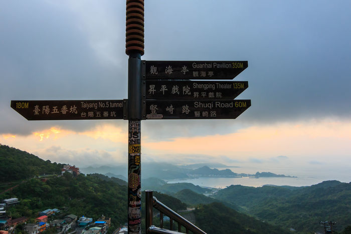 The Signboard at Jiufen, Taiwan Arrow Symbol Beauty In Nature Cloud - Sky Communication Direction Directional Sign Guidance Information Information Sign Landscape Mountain Nature No People Outdoors Scenics - Nature Sign Sky Symbol Text Tranquility Western Script