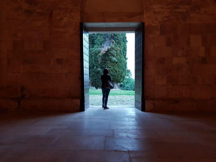 Rear view of woman walking at entrance