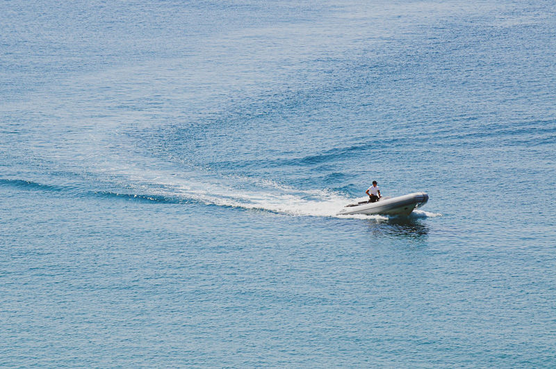 Man in boat on sea