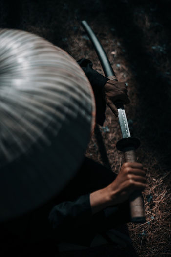 Holding One Person Weapon Gun Real People Men Aiming Nature Rifle Activity Close-up High Angle View Social Issues Selective Focus Outdoors Hunter Smoke - Physical Structure Land Communication Aggression