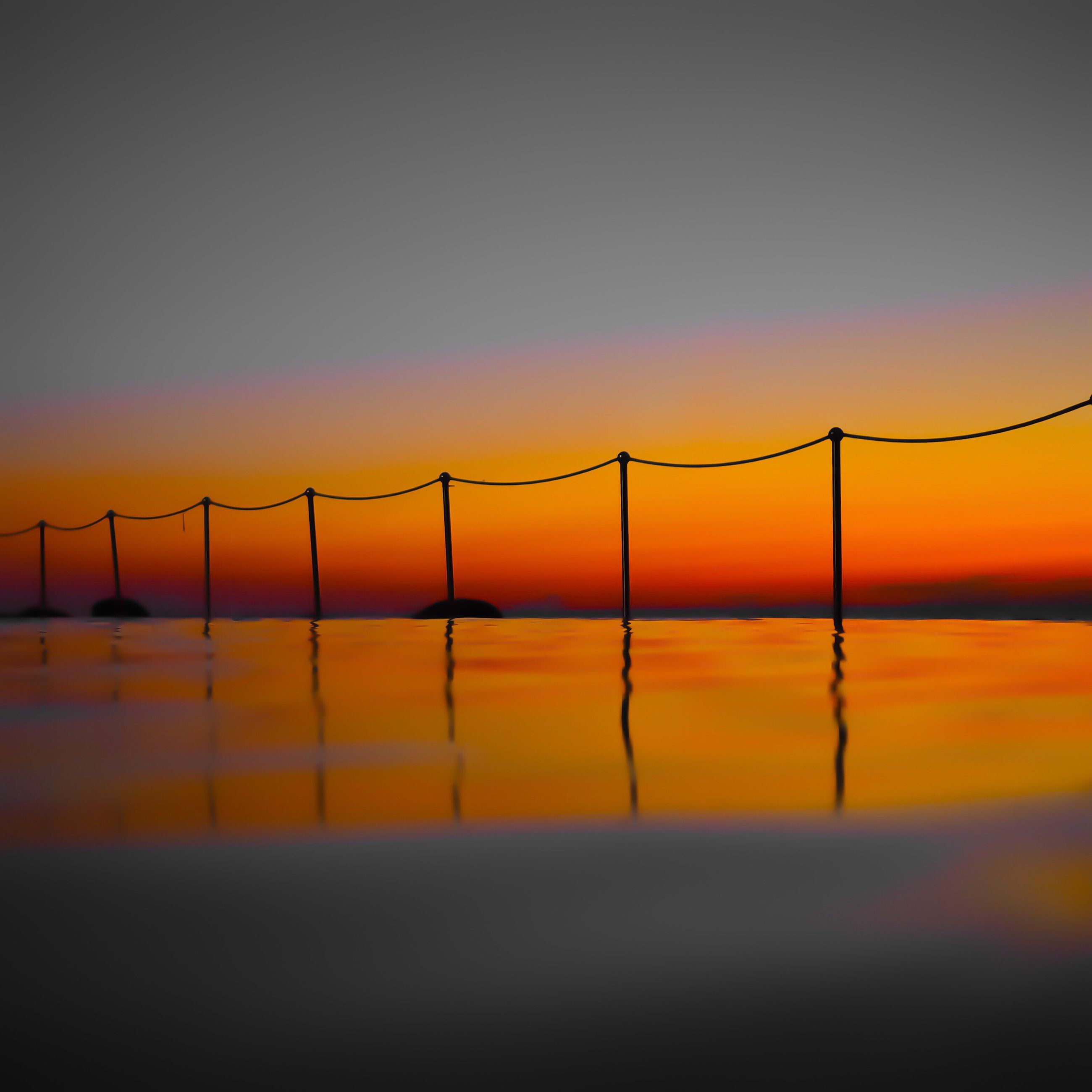 sunset, orange color, nature, beauty in nature, water, no people, bridge - man made structure, connection, sky, sea, suspension bridge, silhouette, outdoors, scenics