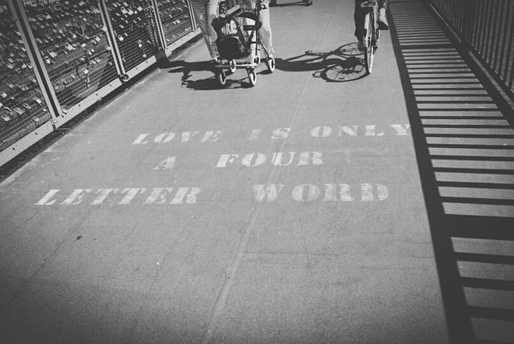 Love is only a four letter word Street Road City Lifestyles Day Outdoors City Life The Way Forward Low Section Love Fourletterword Bridge Aufderbrücke Brücke Köln Germany Deutschland Blackandwhite Tourism Words Words In Picture
