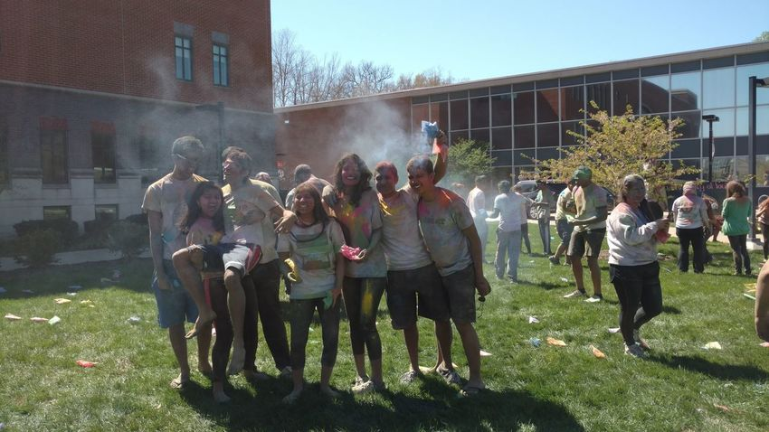 Holi - Festival of Colors! Built Structure Casual Clothing City City Life Day Enjoyment Friendship Full Length Fun Grass Green Color Large Group Of People Leisure Activity Lifestyles Medium Group Of People Men Mixed Age Range Outdoors Sky