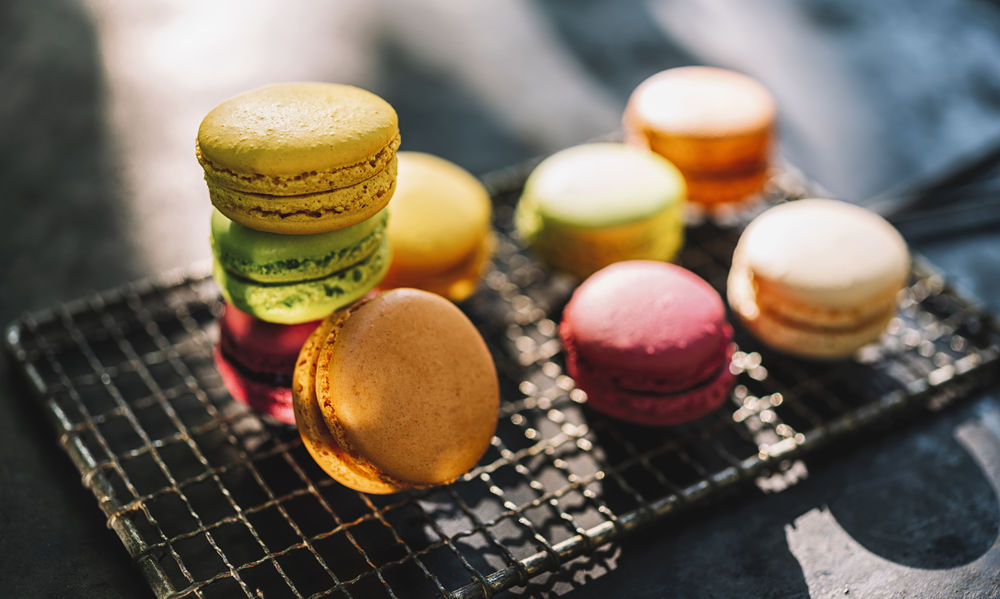 macaron or macaroon cakes in different colors on a grid Belgium Colors Cookies Dessert France Green Grid Macaroons Paris Pink Sugar Biscuit Candy Colorful Confectionery Flavor Food French Macaron Many Pastry Sandwitch Sweet Sweet Food Tasty
