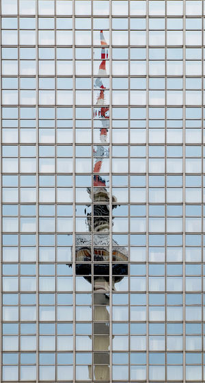 Low angle view of building reflection