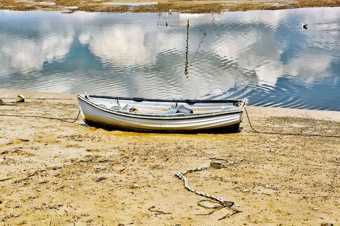 EyeEm Selects Nautical Vessel Water Moored Reflection Transportation Tranquility No People Mode Of Transport Rowboat Lake Day Outdoors Nature Beach