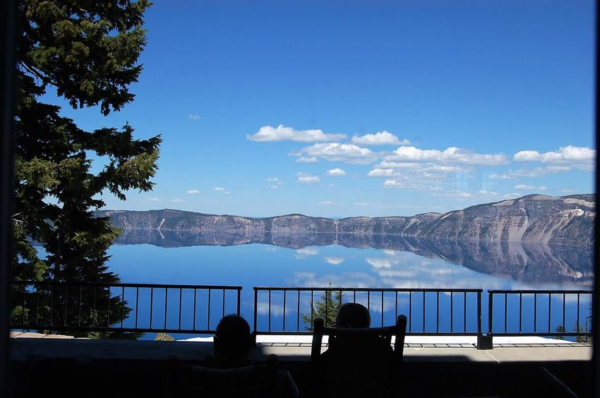 Crater Lake Architecture Beauty In Nature Blue Built Structure Crater Lake Day Mountain Nature Outdoors Real People Scenics Sky Sunlight Tranquility Tree Water