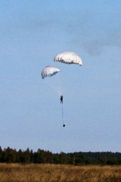 A landing from the air during maneuvers Dragon 11. One of the jumpers did not fully spread the parachute. The reserve parachute saved him. Accident Crash Event Flying Low Angle View Maneuvers Mid-air Military Exercises NATO Parachute Paratroopers Sky Soldiers