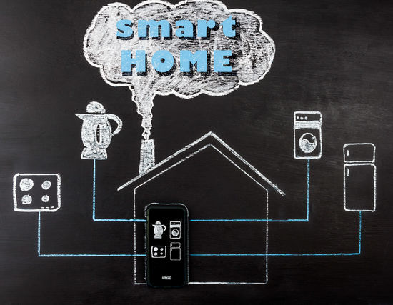 Smart house concept hand drawing on chalk board. Mobile phone controlling home appliances. Horizontal image with text. Copy Space Appliance Blackboard  Chalk Drawing Communication Concept Conceptual Day Drawing No People Smart Home Smart House Technology