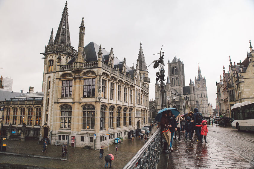 Architecture Belgium Building Exterior Built Structure City City City Life Day Ghent History Large Group Of People Leisure Activity Lifestyles Men Place Of Worship Real People Religion Sky Spirituality Tourism Travel Travel Destinations Walking Winter Women