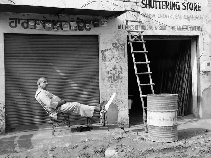Shuttering store keeper. Feet Up Relaxing relaxing moments Man India eyeemblack&white EyeEmNewHere Everyday Lives i Eyeemindia EyeEm Gallery India_clicks Feet Up Relaxing Relaxing Moments Man India Eyeemblack&white EyeEmNewHere EyeEm Best Shots - Black + White Blackandwhite EyeEmBestPics Built Structure Architecture Building Exterior Day Focus On The Story