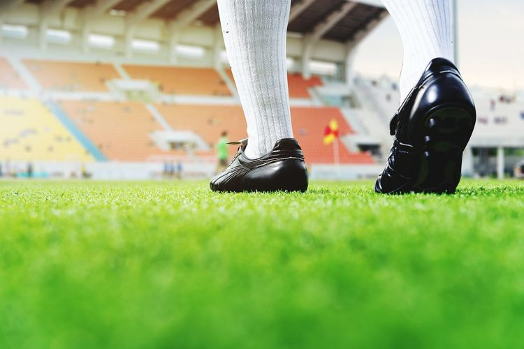 leg football player walking in soccer stadium EyeEm Selects Athlete Low Section Soccer Field Sportsman Competition Soccer Shoe Stadium Sports Clothing Sport Competitive Sport Match - Sport Soccer Player Soccer Uniform Soccer Kicking Soccer Ball Sports Event  Human Foot