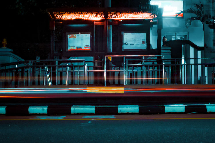 Blurred motion of train in city at night