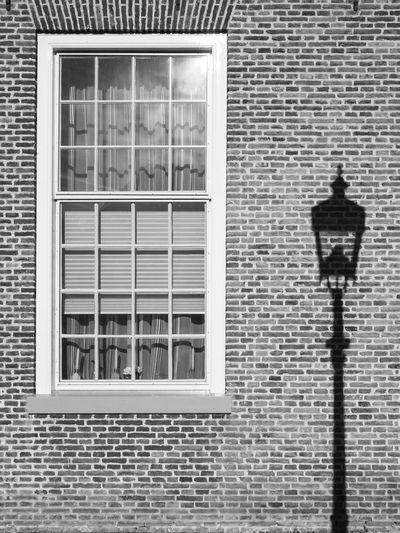 """Lampshade"" Brick Wall Lamppost Lampshade Lantern Shadow Street Street Photography Streetphotography Wall Window"