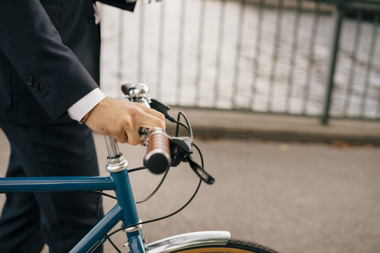 Man holding bicycle in city
