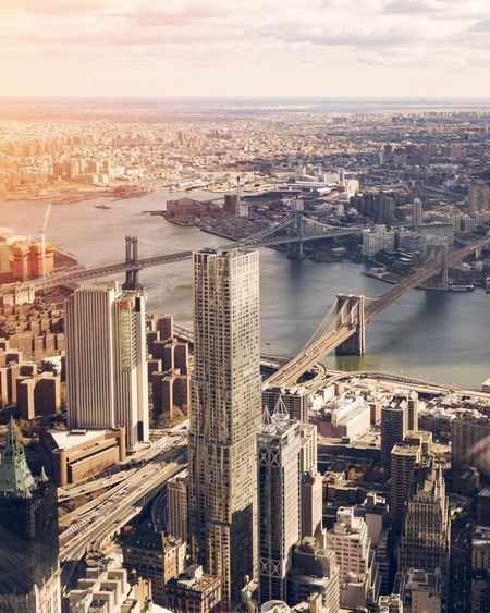 EyeEm Selects New York Cityscape City Architecture Skyscraper Aerial View River Building Exterior Built Structure Bridge - Man Made Structure Travel Destinations Modern High Angle View Sky Urban Skyline Suspension Bridge Outdoors No People Water Downtown District