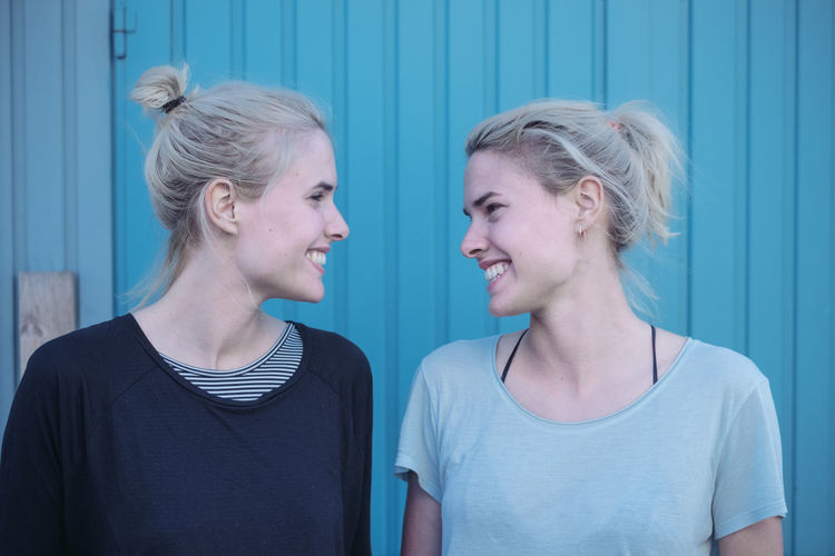 TWINS Blond Hair Casual Clothing Close-up Day Friendship Front View Happiness Indoors  Real People Smiling T-shirt Taking Photos Tank Top Twins Two People Young Adult Young Women The Portraitist - 2017 EyeEm Awards