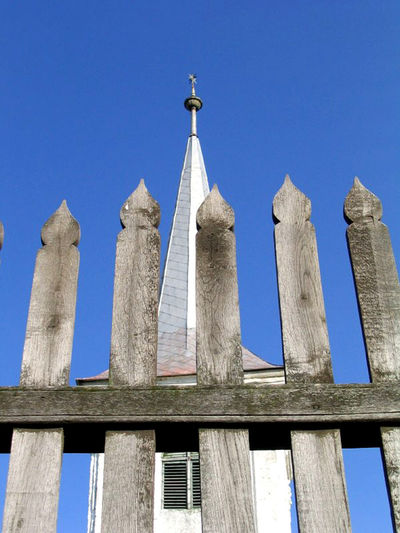 fence and tower Church Palisade Architectural Column Architecture Blue Building Exterior Built Structure Clear Sky Day Fence Low Angle View No People Outdoors Paling Religion Sky Spirituality Tower Tulip Wood - Material