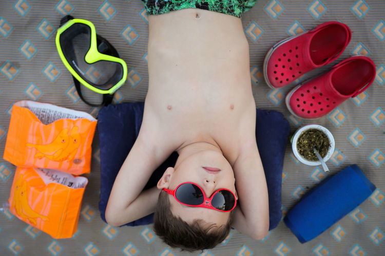Childhood Lying Down Child Directly Above One Person High Angle View Front View Indoors  Relaxation Portrait Lying On Back Real People Innocence Headshot Representation Men Leisure Activity Baby Mouth Open