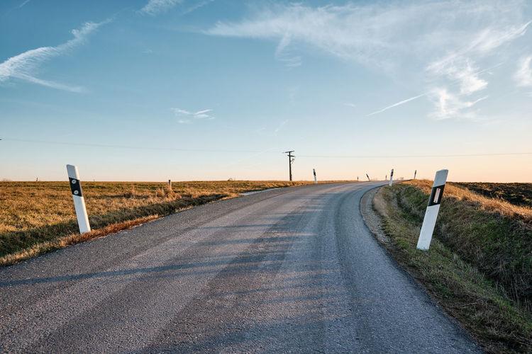 Winding road against sky