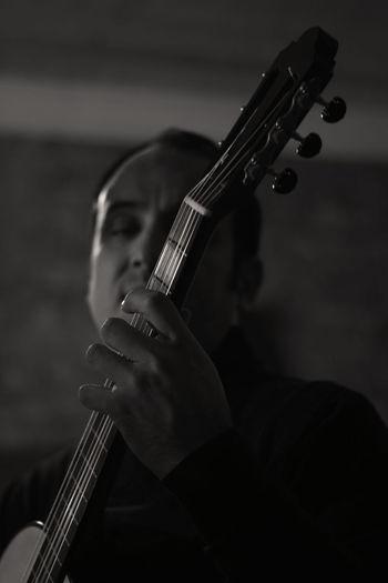 Close-up of man playing guitar
