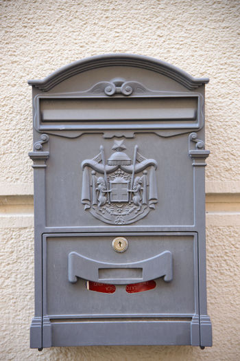 Close-up of mailbox on wall