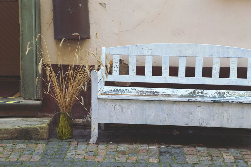 Old Empty Wooden Bench Against House
