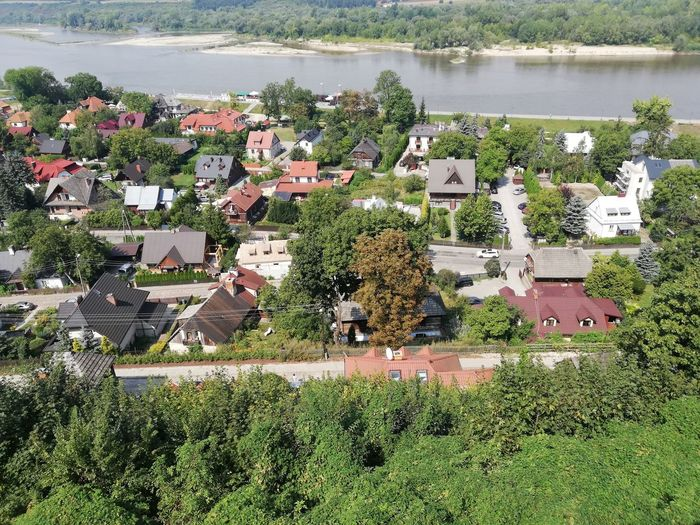 High angle view of houses by lake and buildings