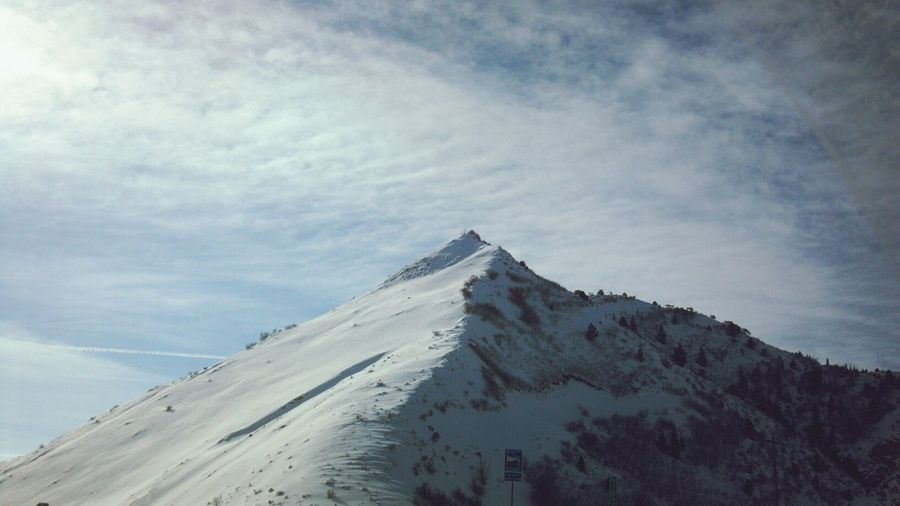 Low angle view of mountain peak against sky