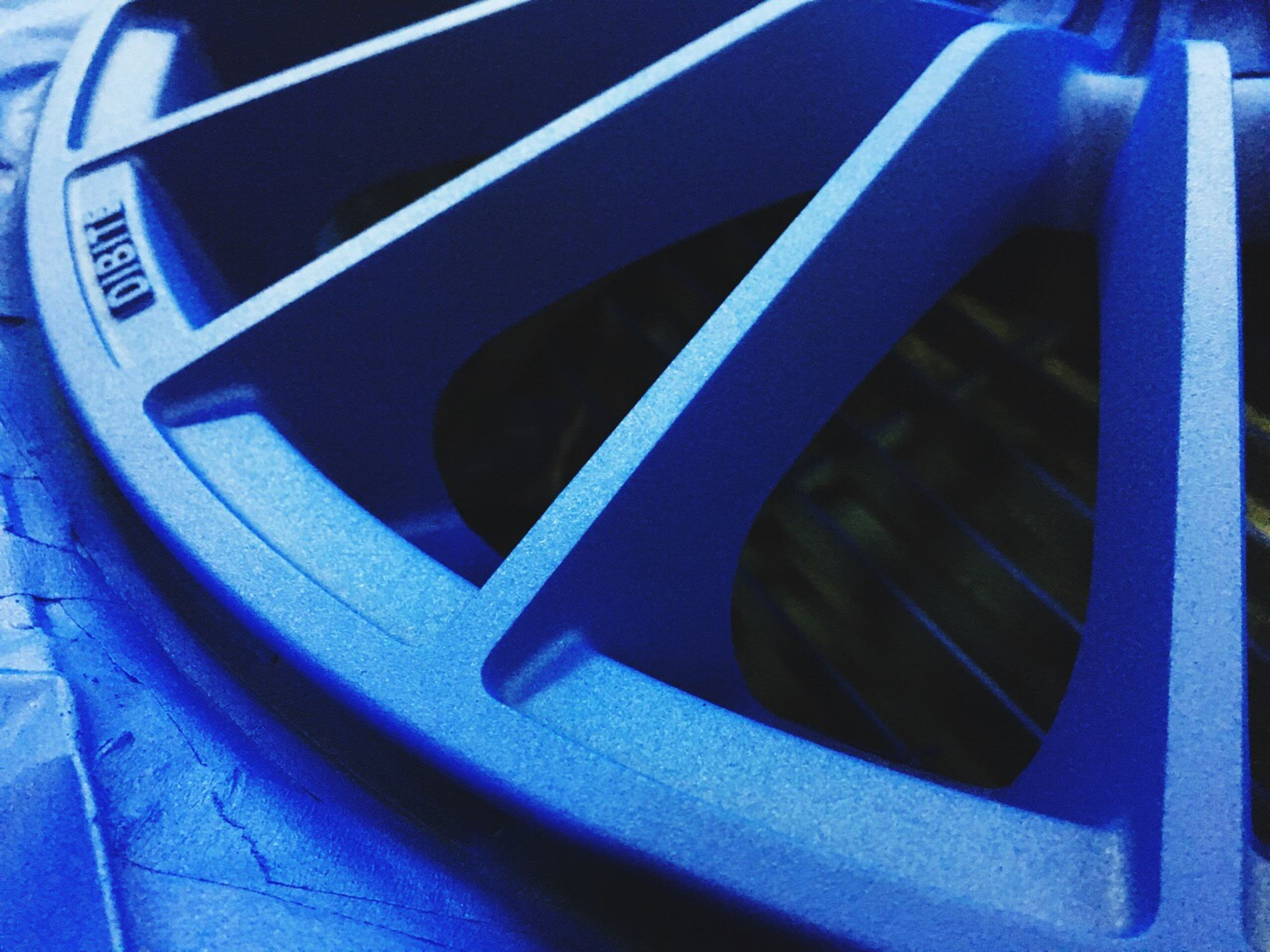 transportation, mode of transport, blue, land vehicle, close-up, metal, car, no people, indoors, part of, sunlight, metallic, day, cropped, low angle view, steps, travel, high angle view, stationary