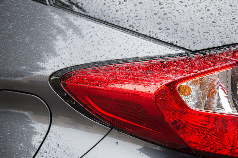 Car Motor Vehicle Red Mode Of Transportation Transportation Land Vehicle No People Wet Water Close-up Day Tail Light Glass - Material Outdoors Reflection Vehicle Hood Drop High Angle View Vehicle Mirror