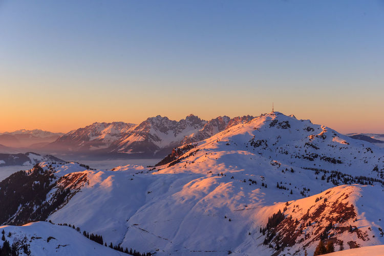 Sunrise over the Kitzbüheler Alps Austria Kitzbühel Beauty In Nature Cold Temperature Kitzbüheler Alpen Mountain Mountain Range Nature Snow Snowcapped Mountain Sunrise Sunset Tranquility Winter