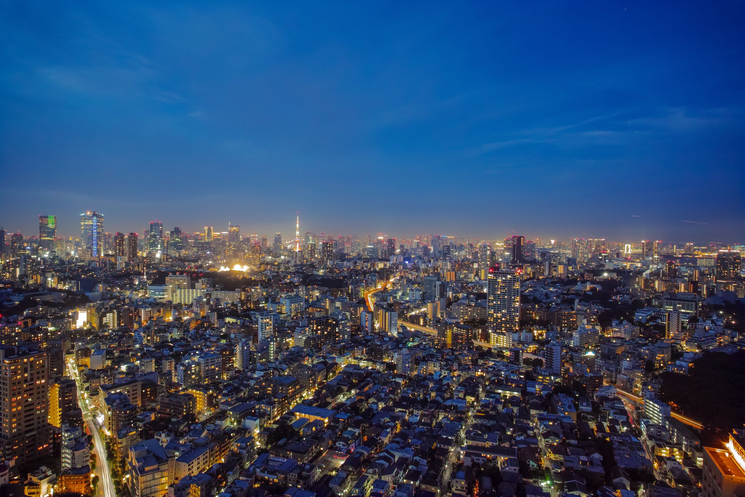 city, cityscape, architecture, illuminated, crowded, modern, skyscraper, building exterior, night, sky, built structure, outdoors, urban skyline